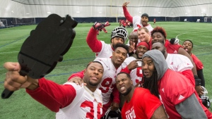 Calgary Stampeders defensive lineman Charleston Hughes (39) takes a group selfie with his twitter mirrors after the western Conference practice ahead of the 104th CFL Grey Cup against the Ottawa Redblacks in Toronto on Friday, November 25, 2016. (Ryan Remiorz/The Canadian Press)