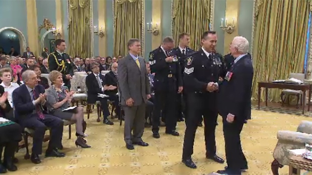 Seven Vancouver police officers received Meritorious Service Decorations from Governor General David Johnston on Friday for their off-duty work filming drug use, poverty and despair in their city's troubled east side.