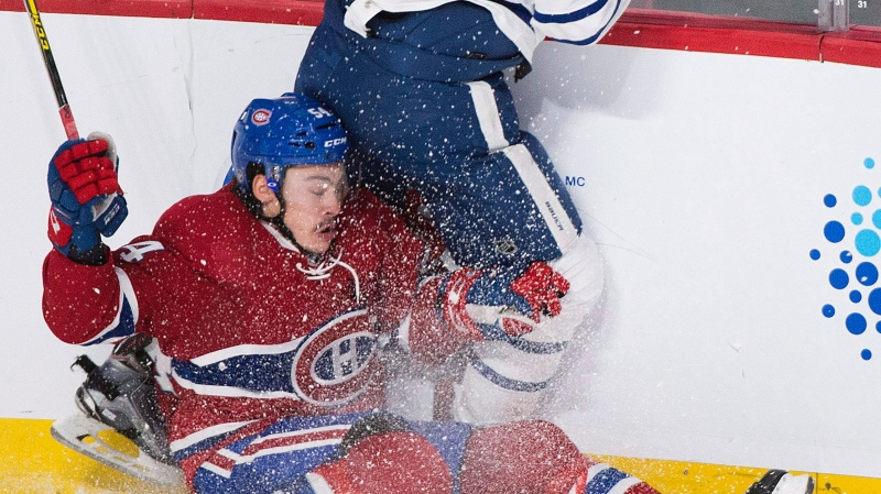 Montreal Canadiens' Charles Hudon (54) collides with Toronto Maple Leafs' Connor Brown during third period NHL hockey action in Montreal, Saturday, November 19, 2016. THE CANADIAN PRESS/Graham Hughes