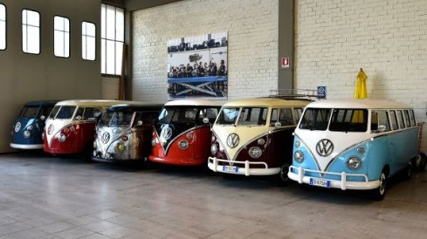 Vintage Volkswagen Kombi Bus Van Transporter Or Camper Are Parked In A Garage After Being Completely Restored By Mechanics Of The T1 Specialist Company