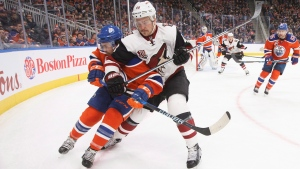 Arizona Coyotes' Jamie McGinn (88) elbows Edmonton Oilers' Kris Russell (4) during third period NHL action in Edmonton, Alta., on Sunday, November 27, 2016. (Jason Franson/The Canadian Press)