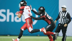 Calgary Stampeders wide receiver Lemar Durant (1) runs in for a touchdown as Ottawa Redblacks defensive back Forrest Hightower (23) defends during third quarter CFL Grey Cup action Sunday, November 27, 2016 in Toronto. (Frank Gunn/The Canadian Press)