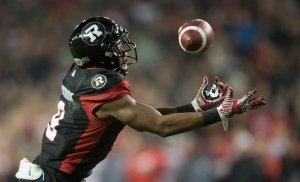 Ottawa Redblacks wide receiver Ernest Jackson (9) catches a touchdown pass during overtime CFL Grey Cup action Sunday, November 27, 2016 in Toronto. THE CANADIAN PRESS/Nathan Denette