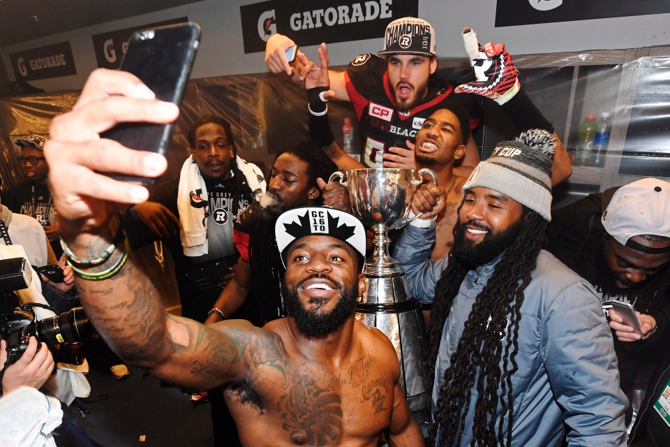 Ottawa Redblacks players take a selfie in their locker room as they celebrate their Grey Cup win over the Calgary Stampeders in Toronto on Sunday, November 27, 2016. THE CANADIAN PRESS/Frank Gunn