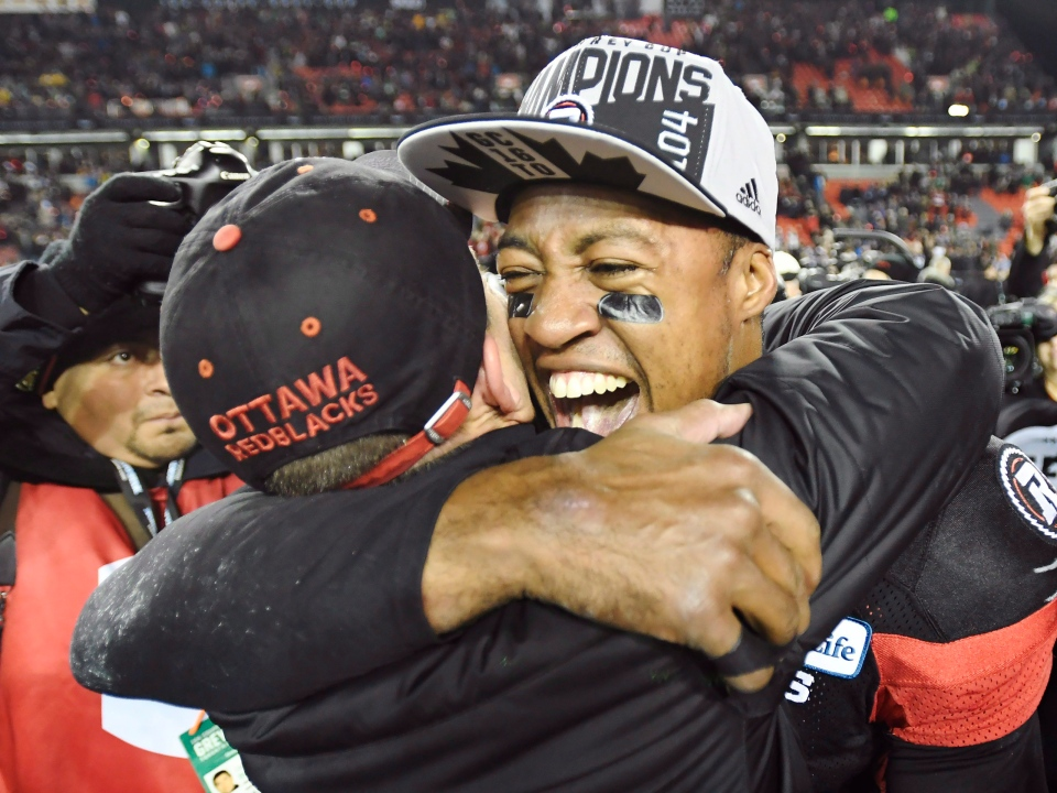 Ottawa Redblacks quarterback Henry Burris (1) and head coach Rick Campbell celebrate their Grey Cup win over the Calgary Stampeders in Toronto on Sunday, November 27, 2016. THE CANADIAN PRESS/Frank Gunn