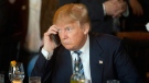 Donald Trump listens to his mobile phone in North Charleston, S.C., on Feb. 18, 2016. (Matt Rourke / AP)