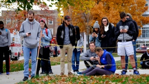 Students gather near the scene of an attack on the campus at Ohio State University on Monday, Nov. 28, 2016, in Columbus, Ohio. (Adam Cairns/The Columbus Dispatch via AP)