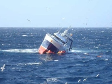 Spanish fishing trawler, the Monte Galineiro, takes on water off the coast of Newfoundland on Sunday Feb. 22, 2009. (THE CANADIAN PRESS / Canadian Coast Guard)