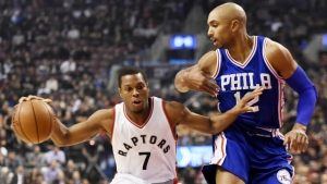 Toronto Raptors guard Kyle Lowry drives to the net against Philadelphia 76ers guard Gerald Henderson during first half NBA basketball action in Toronto on Monday, Nov. 28, 2016. (Nathan Denette / THE CANADIAN PRESS)