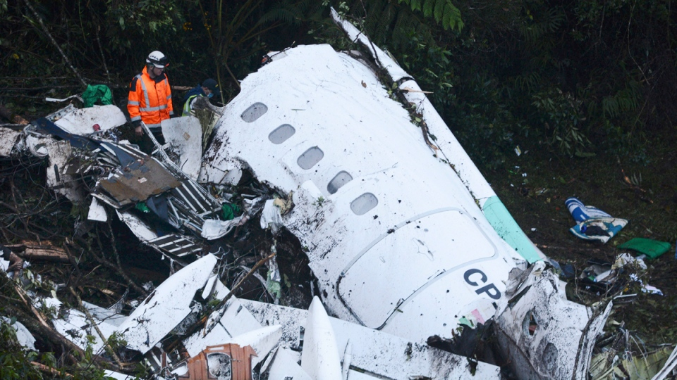 Rescue workers search at the wreckage site of a chartered airplane that crashed outside Medellin, Colombia, on Nov. 29, 2016. (Luis Benavides / AP)