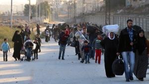 People fleeing rebel-held eastern neighborhoods of Aleppo into the Sheikh Maqsoud are, on Nov. 27, 2016. (The Rumaf via AP)