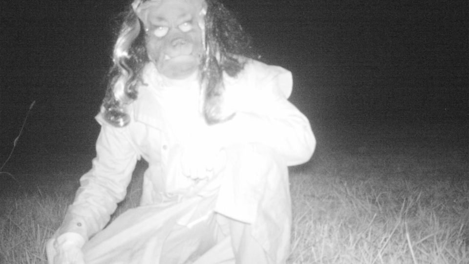 This photo shows a man in a mask captured on a wildlife camera. (Gardner Police Department)