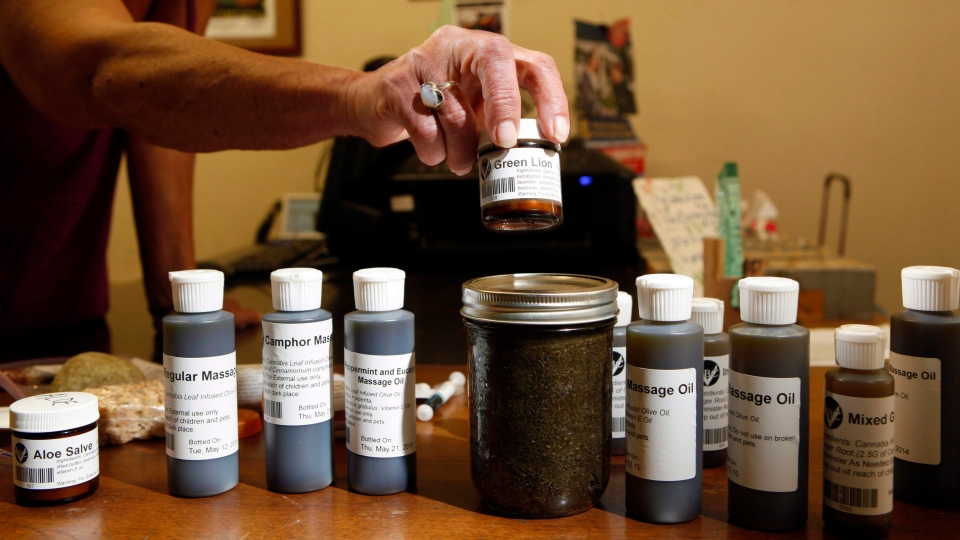 In this file photo, various uses for cannabis oil are sold to customers at the Cannabis Buyers Club, in Victoria B.C., Thursday June 11, 2015. (THE CANADIAN PRESS / Chad Hipolito)