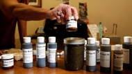 Various uses for cannabis oil are sold to customers at the Cannabis Buyers Club, in Victoria B.C., Thursday June 11, 2015. (THE CANADIAN PRESS / Chad Hipolito)