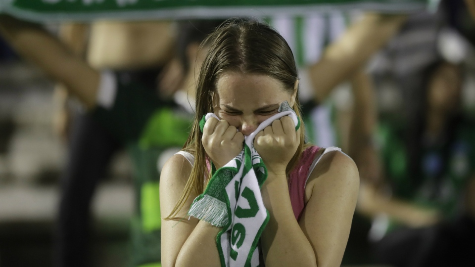 A fan of Brazil's soccer team Chapecoense mourns during a gathering inside Arena Conda stadium in Chapeco, Brazil on Tuesday, Nov. 29, 2016. (AP / Andre Penner)
