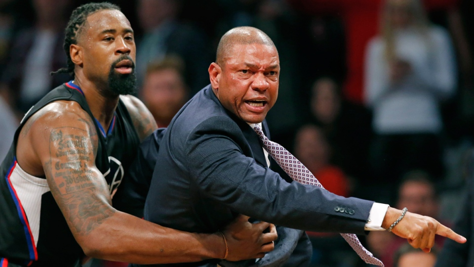 Los Angeles Clippers' DeAndre Jordan, left, restrains Clippers coach Doc Rivers in New York, on Nov. 29, 2016, in New York. (Kathy Willens / AP)