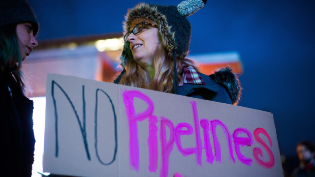 Hundreds of people took to the streets of downtown Vancouver Tuesday night to protest the federal government's approval of the Kinder Morgan pipeline expansion, a decision that will see a dramatic increase of tanker traffic on the West Coast. Environmentalists, First Nations, and politicians were among those who gathered in opposition of the pipeline expansion. (Canadian Press)
