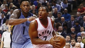 Toronto Raptors' Kyle Lowry drives to the net past Memphis Grizzlies' Jarell Martin during the first half of NBA basketball action in Toronto on Wednesday, Nov. 30, 2016. (Mark Blinch / THE CANADIAN PRESS)