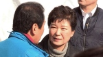 South Korean President Park Geun-hye, right, talks with Seomun Market Merchant Association President Kim Yong-oh during her visit to the Seomun Market which was burned by a recent fire in Daegu, South Korea on Thursday, Dec. 1, 2016. (Kim Jun-bum / Yonhap)