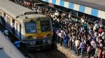 In this Feb. 26, 2015 file photo, commuters wait to catch a train at a railway station in Mumbai, India. (AP Photo/Rafiq Maqbool, File)