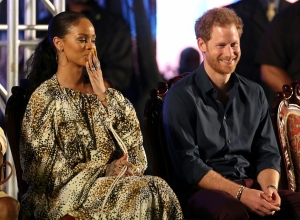 In this photo taken on Wednesday, Nov. 30, 2016, Britain's Prince Harry and Rihanna attend Golden anniversary celebrations at the Kensington Oval cricket ground in Bridgetown, Barbados. (Chris Radburn / PA)