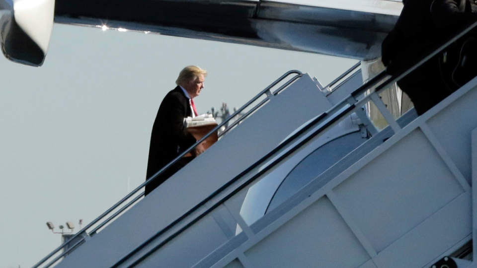 U.S. president-elect Donald Trump boards his plane at La Guardia Airport, in New York, on Dec. 1, 2016. (Richard Drew / AP)