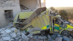 This photo provided by the Shafak Charity Organization, which has been authenticated based on its contents and other AP reporting, shows an ambulance destroyed following four consecutive airstrikes on a medical facility dedicated to women in the northern Idlib province, Syria, Friday, Nov. 25, 2016. Two civilians were killed. (Shafak Charity Organization via AP)