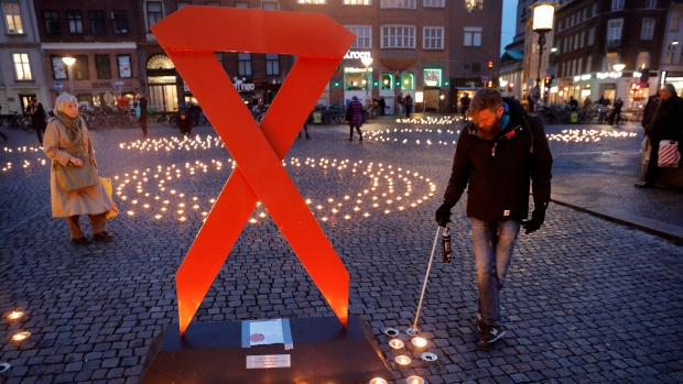 Two Thousand candles were lit in memory of victims of AIDS on World AIDS Day at Gammeltorv Square in Copenhagen, Denmark, on Thursday, Dec. 1. 2016. (Jens Dresling/Polfoto via AP)