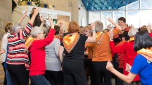 Grandmothers for Grandmothers raise awareness of World AIDS Day with a flash mob at Ryerson University, in Toronto, on Thursday, Dec. 1, 2016.