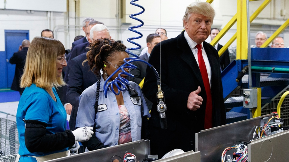 U.S. President-elect Donald Trump talks with workers during a visit to Carrier factory, Thursday, Dec. 1, 2016, in Indianapolis, Ind. (AP / Evan Vucci)