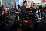 Disabled people with their families march during an anti-government rally in central Athens on Friday, Dec 2, 2016. (AP Photo/Thanassis Stavrakis)