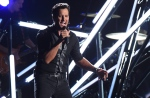 In this Nov. 2, 2016, file photo, Luke Bryan performs 'Move' at the 50th annual CMA Awards at the Bridgestone Arena in Nashville, Tenn. (Photo by Charles Sykes/Invision/AP, File)