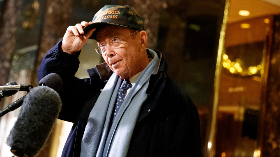 Billionaire investor Wilbur Ross talks with reporters in the lobby of Trump Tower, on Nov. 29, 2016. (Evan Vucci/THE ASSOCIATED PRESS)