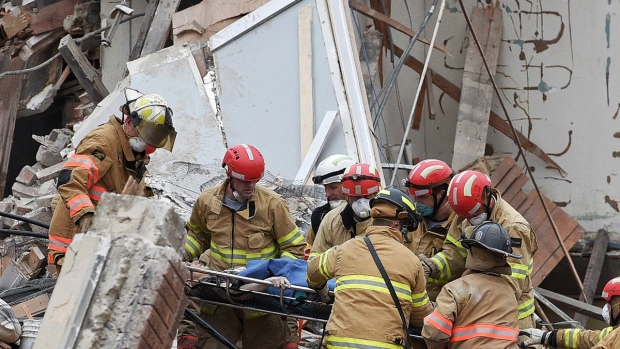 Emergency crews rescue a woman from a building collapse Friday Dec. 2, 2016 in downtown Sioux Falls. (Joe Ahlquist / Argus Leader via AP)