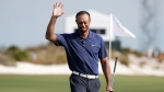 Tiger Woods waves as he walks off the 18th hole during the second round at the Hero World Challenge golf tournament, on in Nassau, Bahamas, Friday, Dec. 2, 2016. (AP Photo/Lynne Sladky)
