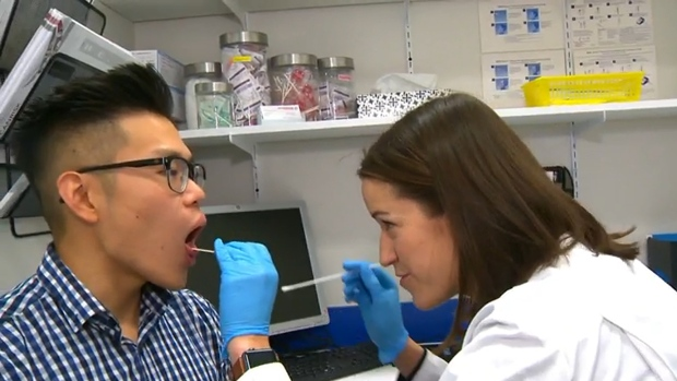 Ashley Davidson, right, a pharmacist with Shoppers Drug Mart in Alberta, administers a new type of diagnostic test that can detect the flu or strep throat in minutes.