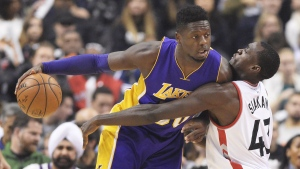 Los Angeles Lakers forward Julius Randle (30) protects the ball from Toronto Raptors forward Pascal Siakam (43) during first half NBA basketball action in Toronto on Friday, December 2, 2016. THE CANADIAN PRESS/Frank Gunn