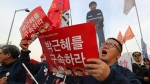 Protesters shout slogans near a cutout of South Korean President Park Geun-hye as they march toward the presidential house during a rally calling for South Korean President Park Geun-hye to step down in Seoul, South Korea, Saturday, Dec. 3, 2016. Rallying for the sixth straight weekend in what has become perhaps South Korea's biggest protests ever, demonstrators in Seoul on Saturday got the closest yet to the president they desperately want removed. (AP Photo/Lee Jin-man)