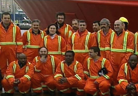 Rescued crew members stop for a photo upon arrival in St. John's, NL, on Monday, Feb. 23, 2009.