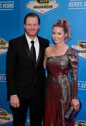 Dale Earnhardt Jr., left, and Amy Reimann pose on the red carpet during the NASCAR Sprint Cup Series auto racing awards in Las Vegas Friday, Dec. 2, 2016. (AP / John Locher)