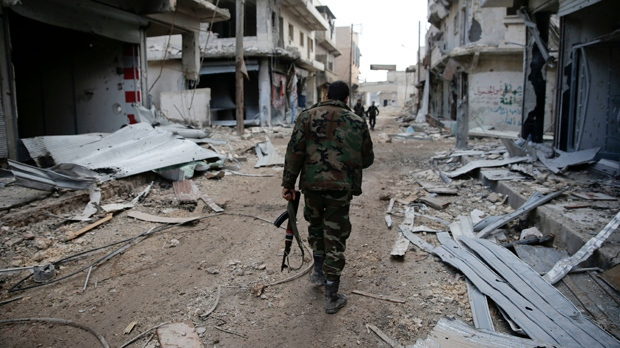 Syrian army soldiers patrol the east Aleppo neighborhood of Tariq al-Bab, Syria, Saturday, Dec. 3, 2016. Tariq al-Bab was captured by Syrian government forces on Friday. (AP Photo/Hassan Ammar)