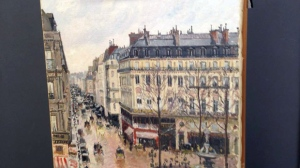 "This Sept. 22, 2014 photo made available by Professor Jonathan Petropolous shows Camille Pissarro's 1897 Impressionist masterpiece, ""Rue Saint-Honoré, dans l'après-midi.(Jonathan Petropolous via AP)"