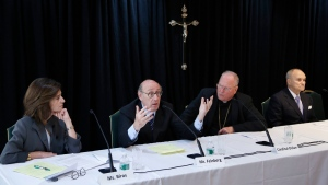 FILE - In this Oct. 6, 2016 file photo, Kenneth Feinberg, second from left, speaks while Camille Biros, left, Cardinal Timothy Dolan, Archbishop of New York, second from right, and former New York City Police Commissioner Raymond Kelly listen during a news conference in New York announcing a new program intended to provide reconciliation and compensation for victims of sexual abuse by clergy. (AP Photo/Seth Wenig, File)
