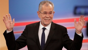 Presidential candidate Alexander Van der Bellen, a former leading member of the Greens Party, raises his arms in the Hofburg in Austria's capital Vienna Sunday, Dec. 4, 2016, after the first official results from the Austrian presidential election showed the left-leaning candidate with what appears to be an unbeatable lead over right-winger Norbert Hofer. (Matthias Schrader/AP Photo)