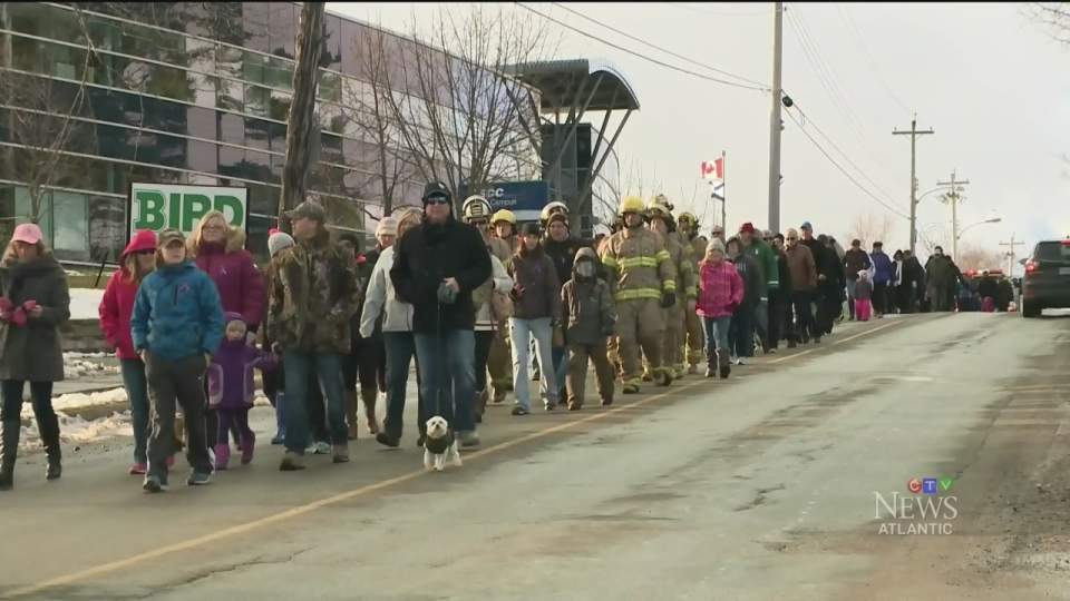 Friends and family of Catherine Campbell march through Stellarton, N.S., in her memory on Sunday, Dec. 4, 2016.