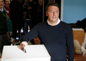 Italian Premier Matteo Renzi casts his ballot at a polling station in Pontassieve, Italy, Sunday, Dec. 4, 2016.  (AP Photo/Antonio Calanni)