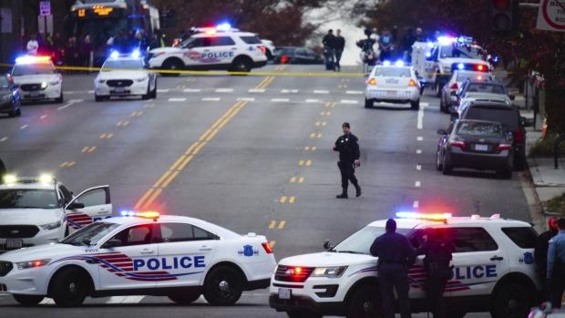 Police secure the scene near Comet Ping Pong in Washington, Sunday, Dec. 4, 2016. (Sarah L. Voisin / The Washington Post)