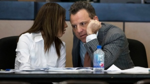 Dalia Dippolito confers with attorney Brian Claypool during motion to request a change of venue at the Palm Beach County Courthouse in West Palm Beach, Fla., on Monday, Dec. 5, 2016. Dippolito faces charges she tried to hire a hit man to kill her newlywed husband in 2009. (Allen Eyestone/Palm Beach Post via AP, Pool)