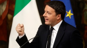 Italian Premier Matteo Renzi gestures a press conference at the premier's office Chigi Palace in Rome, early Monday, Dec. 5, 2016. Renzi acknowledged defeat in a constitutional referendum and announced he will resign on Monday. Italians voted Sunday in a referendum on constitutional reforms that Premier Matteo Renzi has staked his political future on. (AP Photo/Gregorio Borgia)