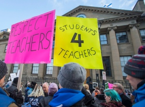 Students and parents protest outside the legislature in Halifax on Monday, Dec. 5, 2016. All Nova Scotia public schools are closed and the government plans to introduce legislation to end their contract dispute with teachers. (THE CANADIAN PRESS/Andrew Vaughan)